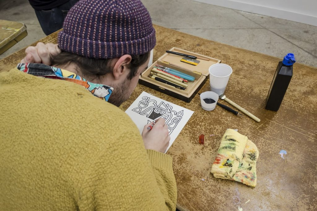 Artist Spencer Pullen drawing at Hot Hands 2017.